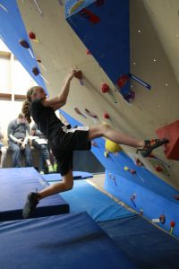 A climber competes in bouldering.