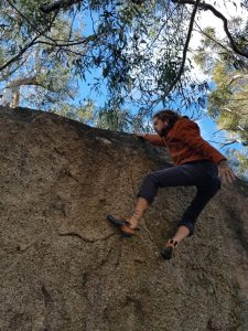Kale McCauley boulders outside in Namadgi National Park.