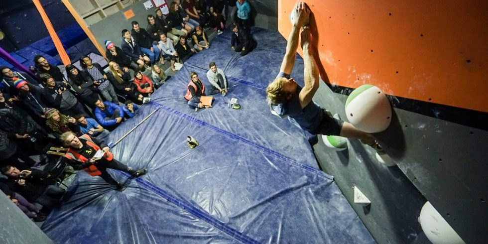 Thomas Farrell tops out on a boulder problem in the 2018 ACT State Boulder Titles