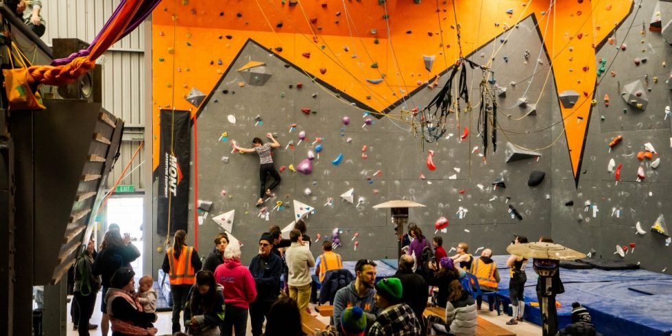 A wide shot showing a busy gym full of people during the 2018 ACT State Bouldering Titles. Photo by Casey Dubois.