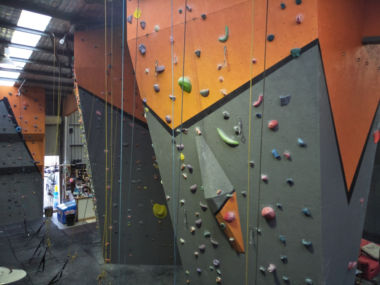 A landscape shot taken from the second floor of our gym in Hume, showing several of our climbing walls.