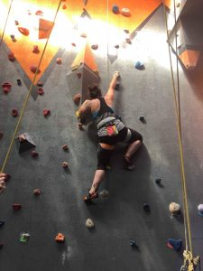A photo of Riahnne Kelly climbing one of the walls at our gym in Hume.
