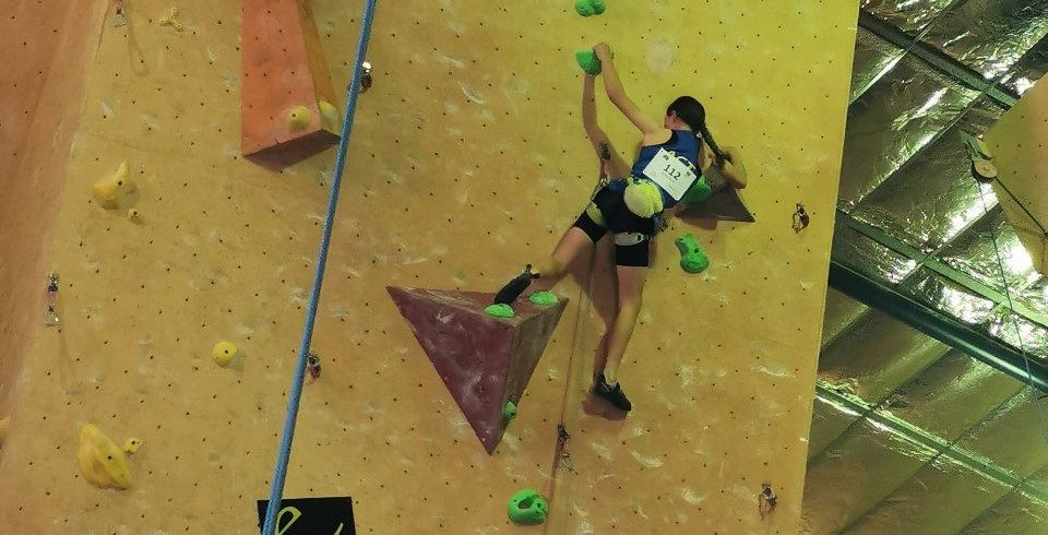 Emily Scott attempts a lead climb at Youth Nationals.