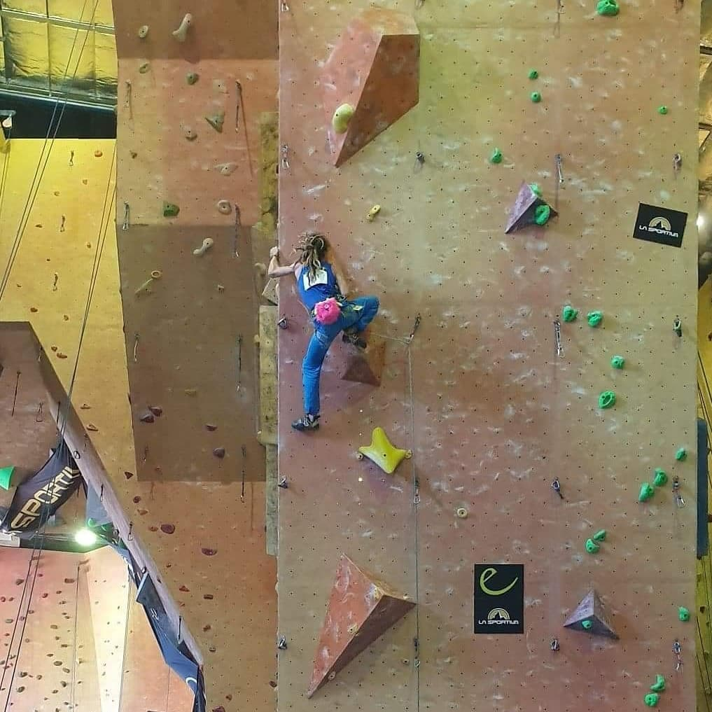 Sam Inglis attempts a lead climb at the Youth National Championships in Sydney.