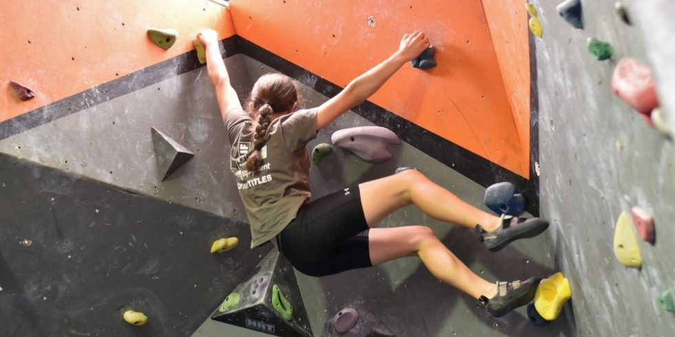 A young climber traverses the walls in one of our bouldering areas.